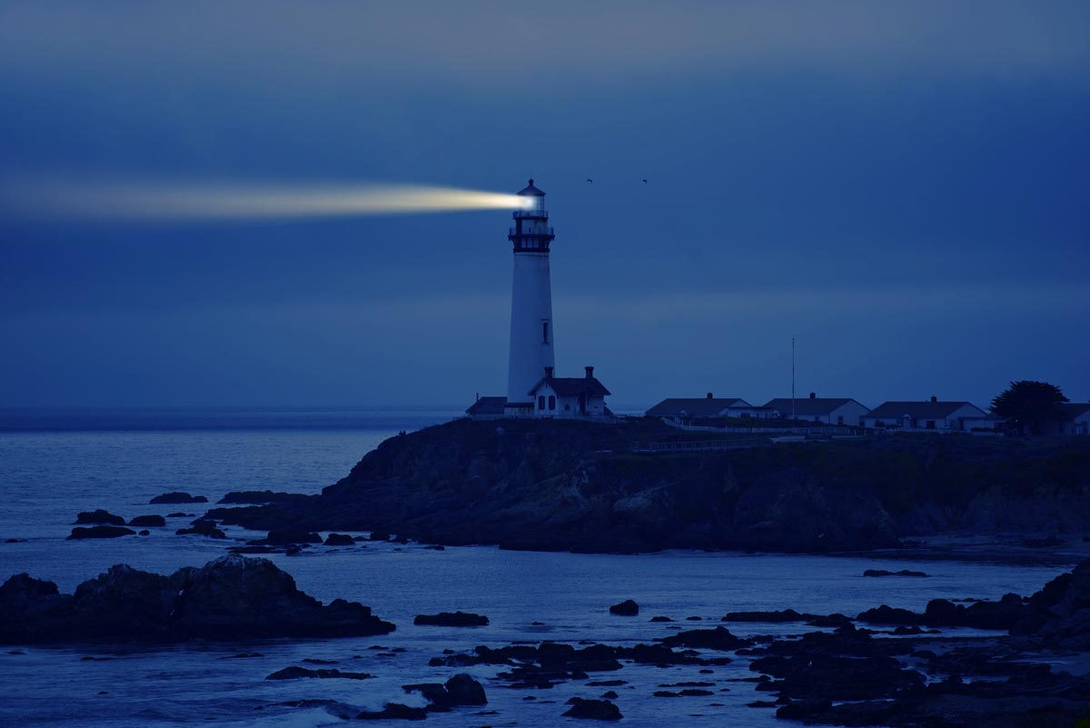 A lighthouse on a rocky seashore, symbolizing how content marketing draws attention to your brand
