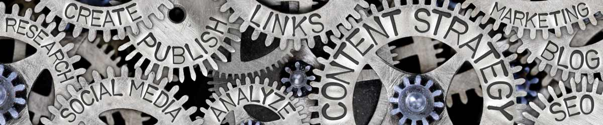 """Gears with phrases written on them such as """"content strategy,"""" """"marketing,"""" and """"social media."""""""